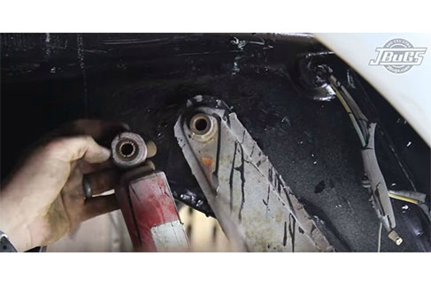 Unbolt and remove the right shock absorber