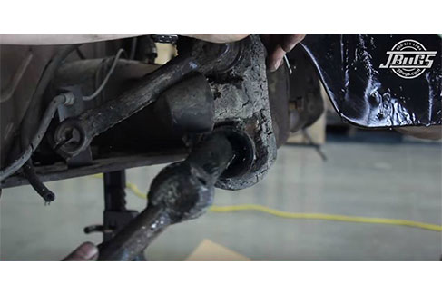 Remove grub screws from trailing arms