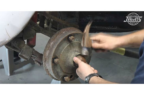 Remove grease cap to access the spindle nuts